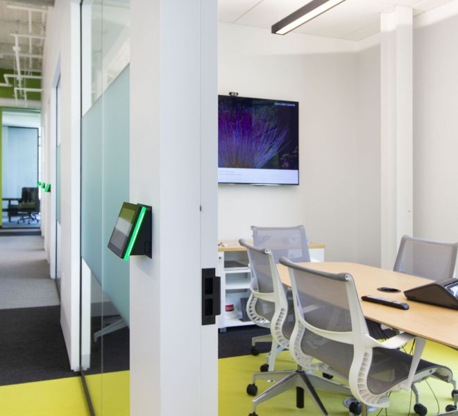 Huddle Room AV Technology with Room Scheduling Panels